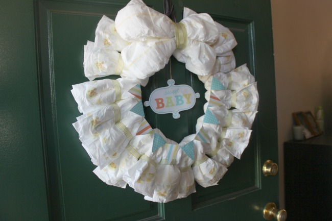 How to make a diaper wreath with instructions 30 ways for Baby shower front door decoration ideas
