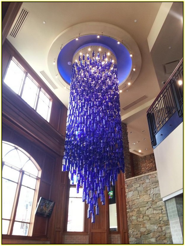 Wine bottle chandelier 13 unique diys guide patterns wine bottle chandelier idea aloadofball Choice Image