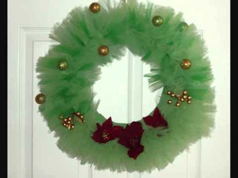 I made a Christmas wreath inspired by this one. Yours is beautiful. I just changed the tulle to red and white and used green ribbon to make flowers. It turned out .
