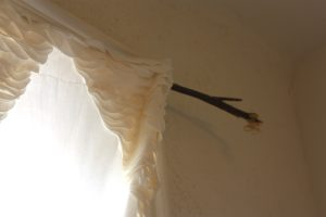 How to Hang a Branch Curtain Rod