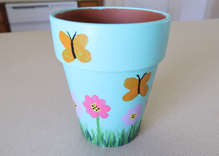 These painted planters or flower pots are a great kid-made gift! They are perfect for Mother's Day or as an end of the school year gift for teachers.