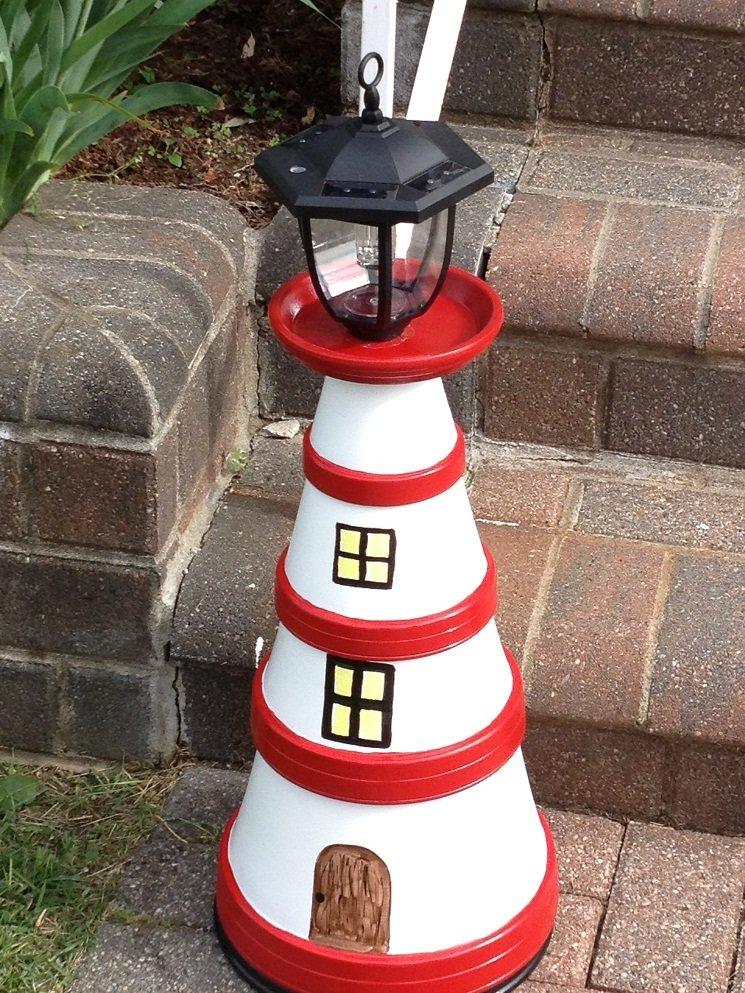 8 simple clay pot lighthouse projects for your garden. Black Bedroom Furniture Sets. Home Design Ideas